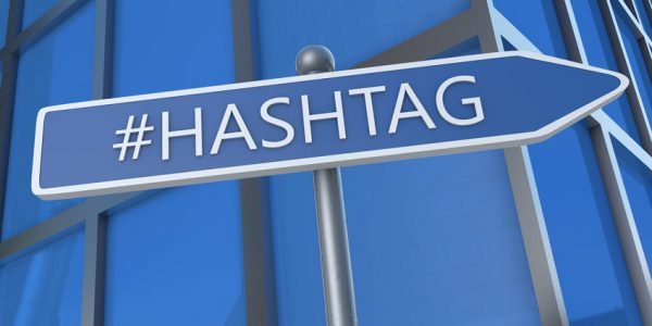 Hashtag - illustration with street sign in front of office building.